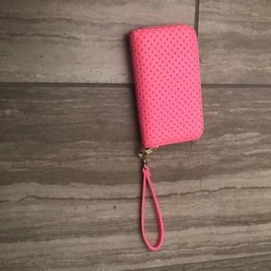 I am selling a pink wristlet